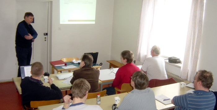 Training going on. A teacher in front of a class.